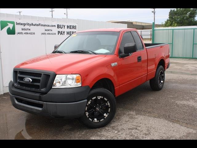 Red Ford truck at Integrity Auto Finance