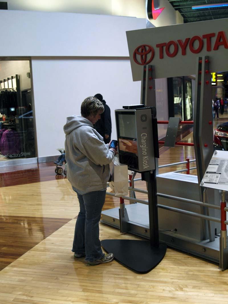 Customer Viewing Toyota Kiosk