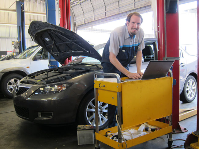 Adam working on a Mazda 6
