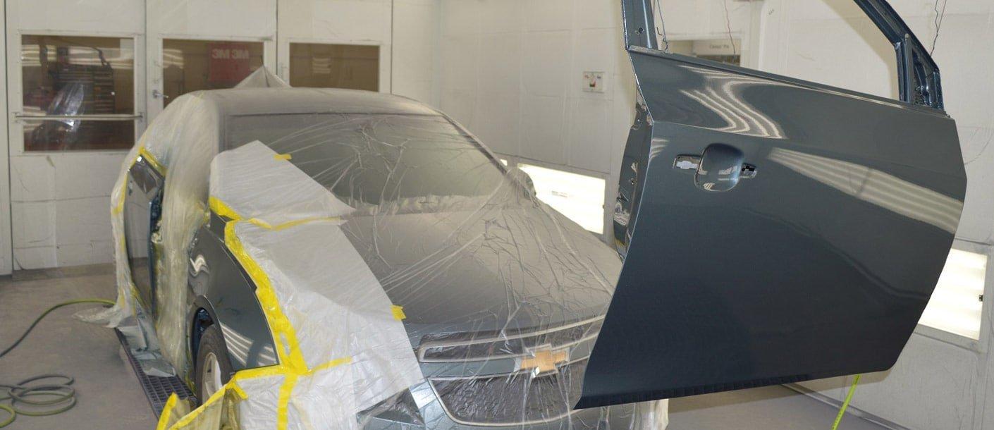 Car And Car Door Being Repainted