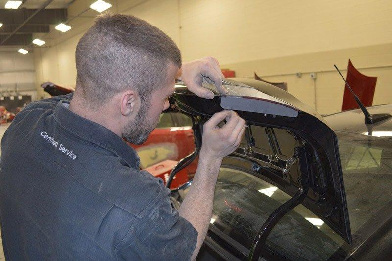 A mechanic repairs a trunk