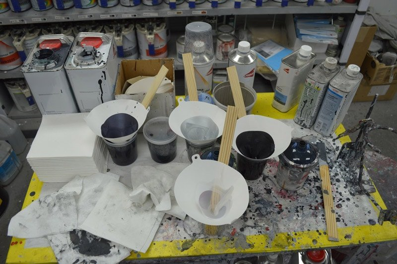 Auto paint being mixed before being applied